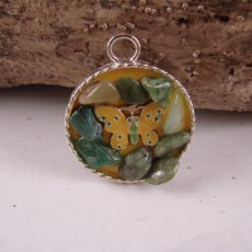 round silver pendant with yellow butterfly