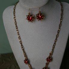 Red and gold rivoli flower necklace and earrings set