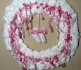 "24"" BABY GIRL WREATH WITH SOCKS AND FAVOR RATTLE AND BOTTLE"