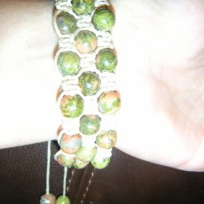 Green stone beads and beige wax cord