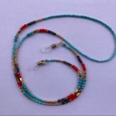 Eye glass holder/necklace in a mixture of multi-colored beads in blues, gold and red.