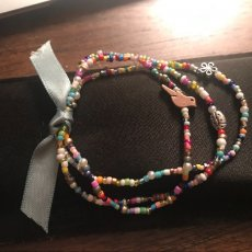 Beaded glass bracelets with charms