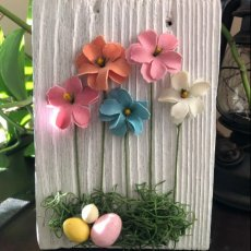 multi-color floral Easter on reclaim barn wood