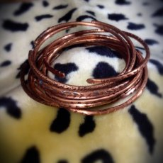 Hammered copper and bronze bangles