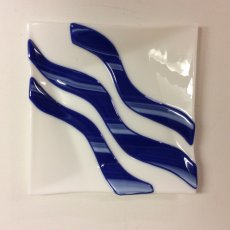 White fused glass plate with blue curves