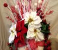 Pointsettias in White Vase