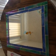 Custom one of a kind Stained glass mirrors of all sizes and prices