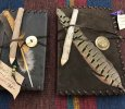 Leather covered journals with twig pencils