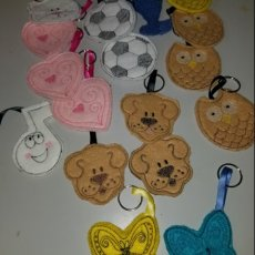 Machine embroidered key fobs/back pack tags