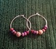 Hoop earrings with stone beads.