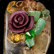 Artful clay roses on amber-colored stone with copper wire-wrapped bail to necklace.