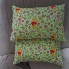 2 winnie the pooh travel sofa pillows .